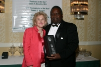 Helen Wilkes with Malachi Knowles receiving award