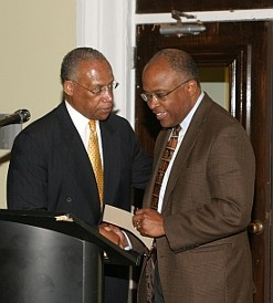 Dr. Marshall Banks, Howard University greets Kurt Schmoke, Dean Howard University School of Law during the Presentation of 2009 AAGHOF Founders Award.