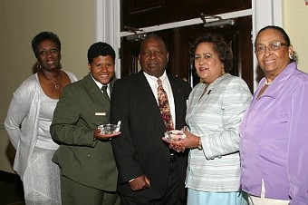 Founder Malachi Knowles congratulates the Wake Robin Golf Club and Gayle Hazelwood from the National Parks Services for their awards during the 2009 AAGHOF Presentatio at the City Museum in D.C.