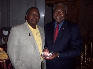 Congressman James E. Clyburn (House Majority Whip) receives Leadership Award from AAGHOF Founder Malachi Knowles.