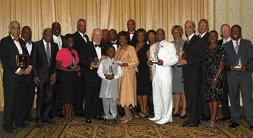Past and present Legends gather for a group photo after the Induction Awards and Celebration on May 29, 2011