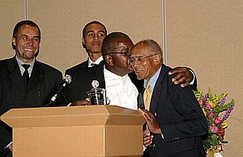 Founder of the AAGHOF Malachi Knowles congratulates Dr. Thomas A. Hart during the AAGHOF Dinner & Induction in Phoenix, Arizona