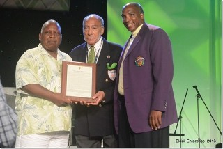 Malachi Knowles presents proclamation to Earl Graves during the Black Enterprise Golf & Tennis Challenge 2013.